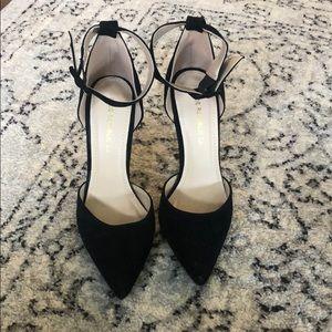 Black suede pointed toe heels